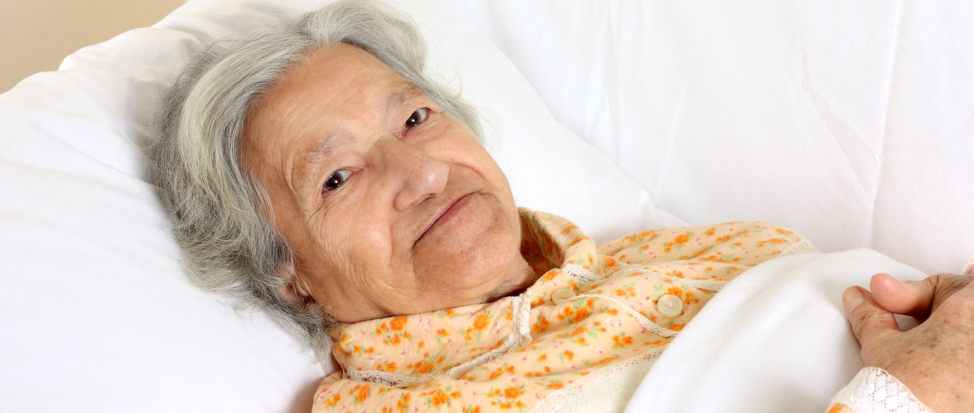 A female elderly in bed